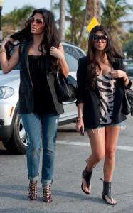 Kim Kardashian and Kourtney Kardashian seen walking together towards Devitos restaurant on March 21st 2010 in Miami Florida 2