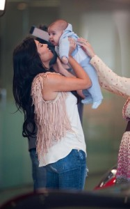 Kim Kardashian with her new born nephew at Prime 112 restaurant on March 18th 2010 in Miami Beach Florida 3