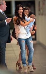 Kim Kardashian and Kourtney Kardashian together with her new born baby boy at Prime 112 restaurant on March 18th 2010 in Miami Beach Florida 1