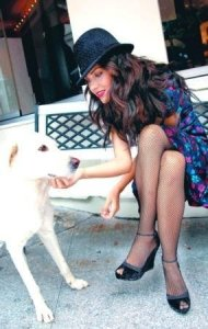 turkish model and actress Tuba Buyukustun glam photo shoot with full makup playing with a cute dog