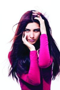 turkish model and actress Tuba Buyukustun glam photo shoot with full makup with a long hair style