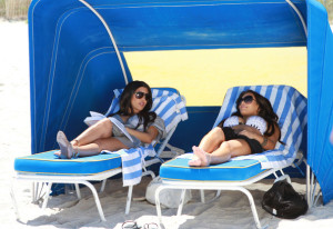 Kim Kardashian and Kourtney Kardashian spotted on March 30th 2010 as they film some scenes for their show Keeping Up with the Kardashians in bikinis on the beach 3