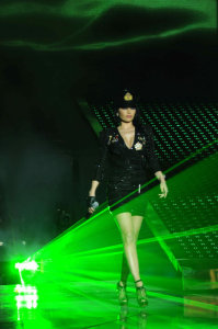 picture on April 9th 2010 from the 8th prime of Star Academy seven of Haifa Wehbe on stage singing solo whikle wearing a glittery black skirt and jacket