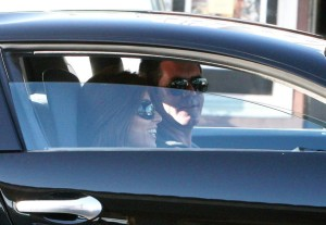 Simon Cowell and his fiance Mezghan Hussainy seen together on March 12th 2010 as they were inside his Bentley in Los Angeles 1