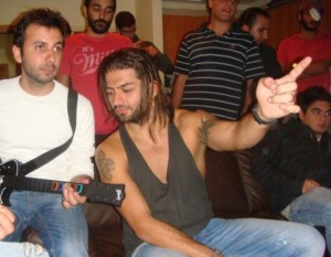 Fadi Andraos photo while at a rock gig event wearing a sleevless top 3