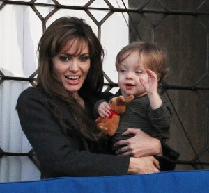 Knox Jolie Pitt drops his doll bunny off his the balcony while with his mother Angelina Jolie on April 9th 2010 in Venice Italy 6