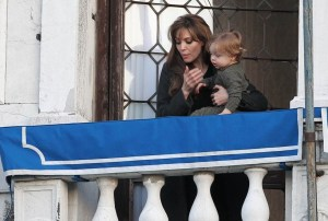 Knox Jolie Pitt drops his doll bunny off his the balcony while with his mother Angelina Jolie on April 9th 2010 in Venice Italy 2
