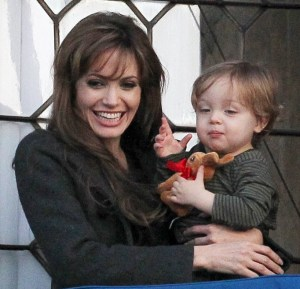 Knox Jolie Pitt drops his doll bunny off his the balcony while with his mother Angelina Jolie on April 9th 2010 in Venice Italy 7