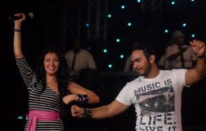 Tamer Hosny with Merhan Hussein on stage during a summer concert 9