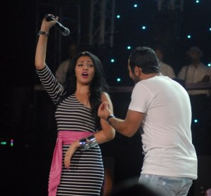 Tamer Hosny with Merhan Hussein on stage during a summer concert 7