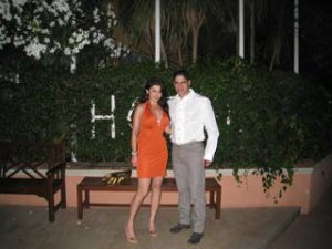 Haifa Wehbe picture with her husband Ahmed abo Hashimah wearing an orange summer dress