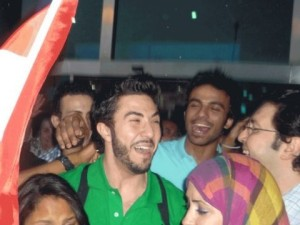 Mahmoud Shokry picture as he reaches Cairo Airport and meets with his fans along with his star academy Egyptian friend Mohamad Ali