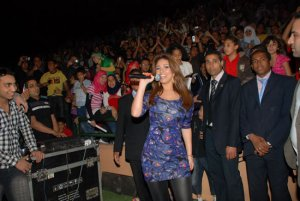 May Sileem performing on stage 5