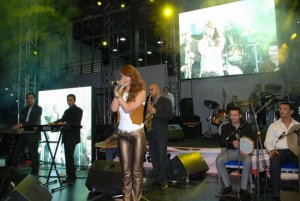 May Sileem performing on stage 1