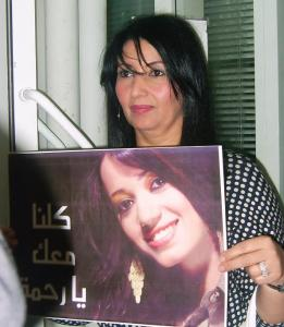 Star Academy Student mother Mrs Fadila holding a poster of her daughter Rahma from Iraq