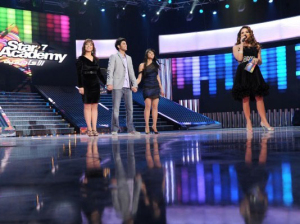 Picture of the three nominees Rahma, Badria, and Ramy together with presenter hilda khalifeh at the fifteenth prime on May 28th 2010 of the 7th season of staracademy 32