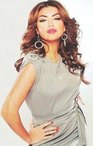 Amal Boshoshah May 2010 photo shoot in a light cream color dress