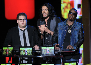 Russell Brand with Jonah Hill and Sean P Diddy Combs speak on stage at the 2010 MTV Movie Awards held at the Gibson Amphitheatre on June 6th 2010 at Universal Studios in California 4