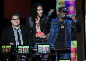 Russell Brand with Jonah Hill and Sean P Diddy Combs speak on stage at the 2010 MTV Movie Awards held at the Gibson Amphitheatre on June 6th 2010 at Universal Studios in California 2