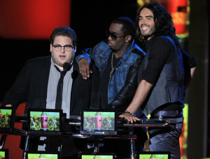 Russell Brand with Jonah Hill and Sean P Diddy Combs speak on stage at the 2010 MTV Movie Awards held at the Gibson Amphitheatre on June 6th 2010 at Universal Studios in California 1