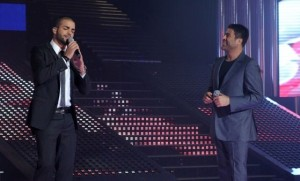 pictrure of the Star Academy 7 prime 16th finale during the performance of singer Wael Kfoury on stage with student Mohamad Ramadan