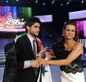 pictrure of the Star Academy 7 prime 16th finale while Nassif Zeitoun od Syria is announced as the winner and handed the trophy by Madam Rola Saed 4