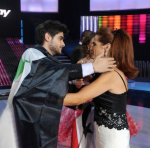 pictrure of the Star Academy 7 prime 16th finale while Nassif Zeitoun od Syria is announced as the winner and handed the trophy by Madam Rola Saed 1