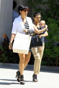 Kris Jenner seen with her daughter Kourtney Kardashian and her grandson Mason Disick on June 14th 2010 while shopping at Naimies Beauty Center 6