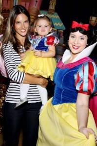 Alessandra Ambrosio with her daughter Anja at the DISNEY Princess Royal Court on March 14th 2010 in Paris 2