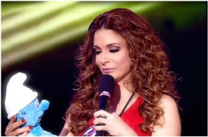 star academy fourth prime on April 22nd 2011 picture of Hilda Khalifeh as she gets a smurf from Houssam Taha