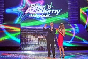 the 8th prime of star academy on May 20th 2011 picture of Ahmed Ezzat as the delegate of the week with hostess Hilda Khalifeh
