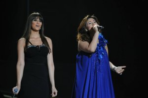 picture from the Star Academy 9th Prime on May 27th 2011 of student Lian Bazlamit singing along with singer Mai Selim