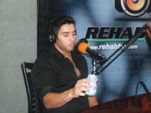 photo of Karim Kamel at the rehab fm radio station studio for a live interview 8