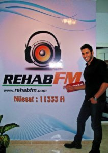 photo of Karim Kamel at the rehab fm radio station studio for a live interview 4
