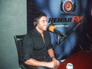 photo of Karim Kamel at the rehab fm radio station studio for a live interview 18