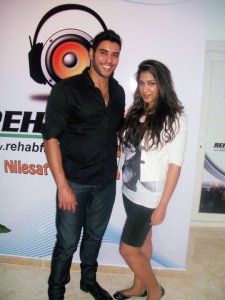 photo of Karim Kamel at the rehab fm radio station studio for a live interview 1