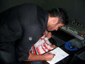 photo of Karim Kamel at the rehab fm radio station studio for a live interview 19