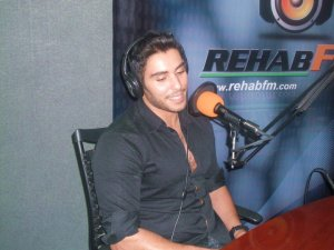 photo of Karim Kamel at the rehab fm radio station studio for a live interview 5