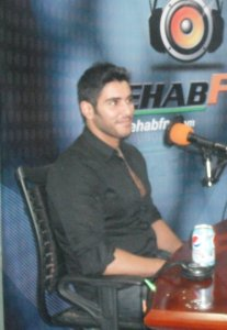 photo of Karim Kamel at the rehab fm radio station studio for a live interview 3