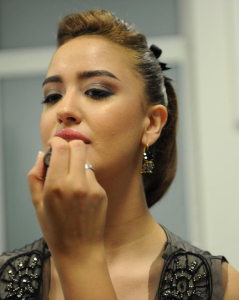 various pictures of Nina Abdel Malak from Lebanon while putting makeup backstage at one of the primes