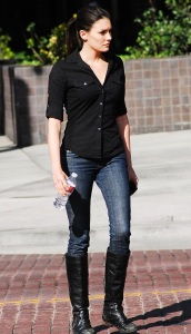 Taylor Cole candid picture while spotted walking the street recently wearing long black boots over denim trousers and a black shirt 2