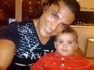 Osvaldo Rios personal photos with a baby 5