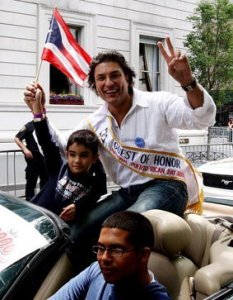 Osvaldo Rios spotted by photographers as he participates at a parade 5