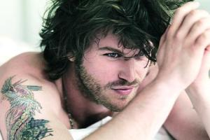 Kivanc Tatlitug arm tattoo picture