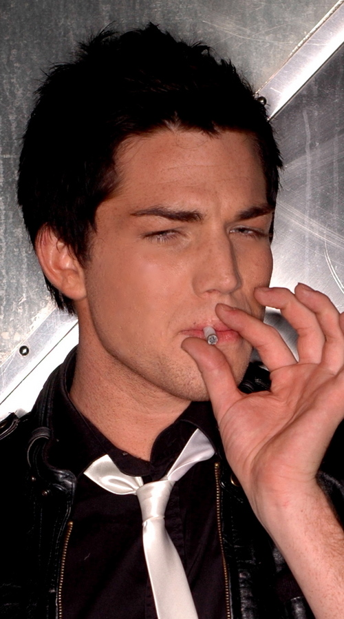 Adam Lambert smoking a cigarette (or weed)