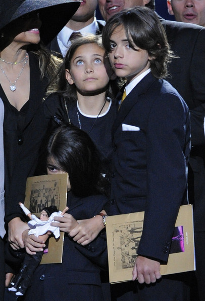 Michael Jacksons daughter Paris Jackson and sons Blanket; Prince Michael Jackson II and Prince Michael Jackson stand on stage during their father memorial
