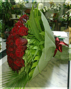 Jwana red roses arrangement photo