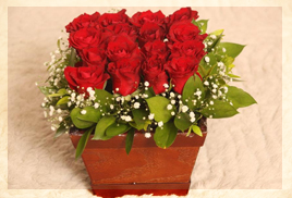 garden of eden red roses arrangement