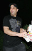 Sam Lutfi old candids with a take-out meal box