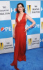 Anne Hathaway posing for the camera in a red long dress